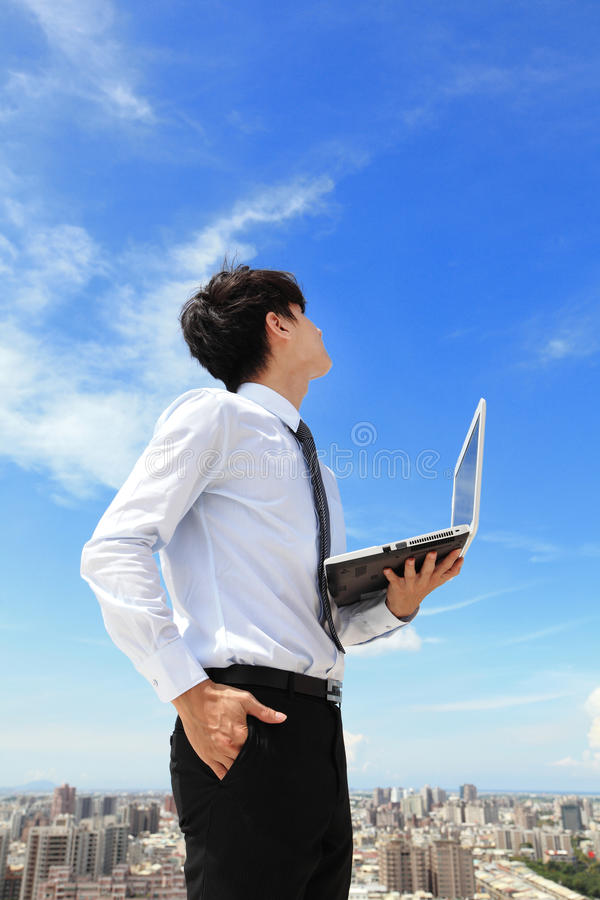 Download Business Man Using Laptop And Look To Blue Sky Stock Photo - Image: 33437830