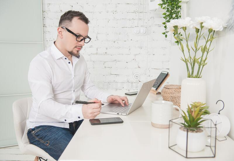 Business man using laptop at home. Freelance or distance study concept royalty free stock photography