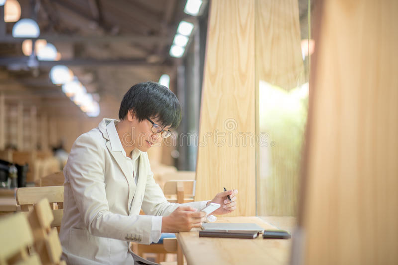 Business man using smartphone and checking his work royalty free stock photo