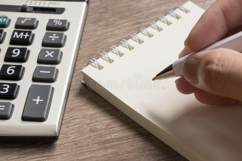 Business man wait to write on blank noted paper royalty free stock photo