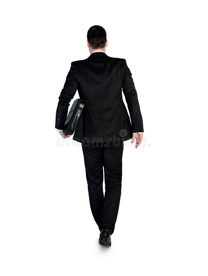 Business man walking back stock photography
