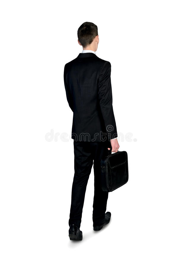 Business man walking back view stock images