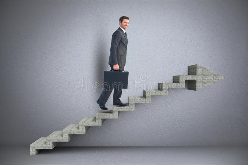 Business man walking on 3d stairs with arrow. Digital composite of Business man walking on 3d stairs with arrow royalty free stock photo