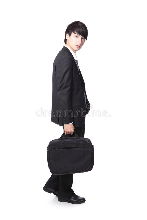 Business man walking and holding briefcase stock image