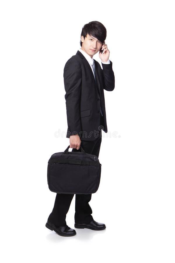 Business man Walking while speaking mobile phon stock image