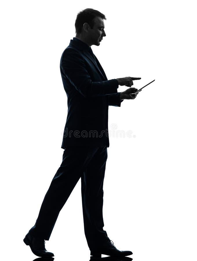 Business man walking touchscreen digital tablet silhouette stock photos