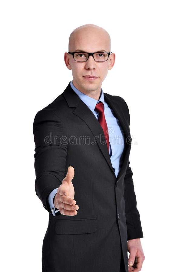 Business man wanting to shake hands with you stock image