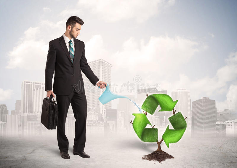 Business man watering green recycle sign tree on city background vector illustration