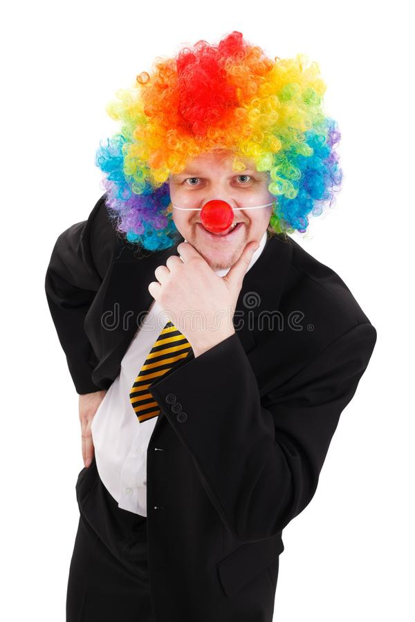 Business man wearing colorful clown wig stock photos