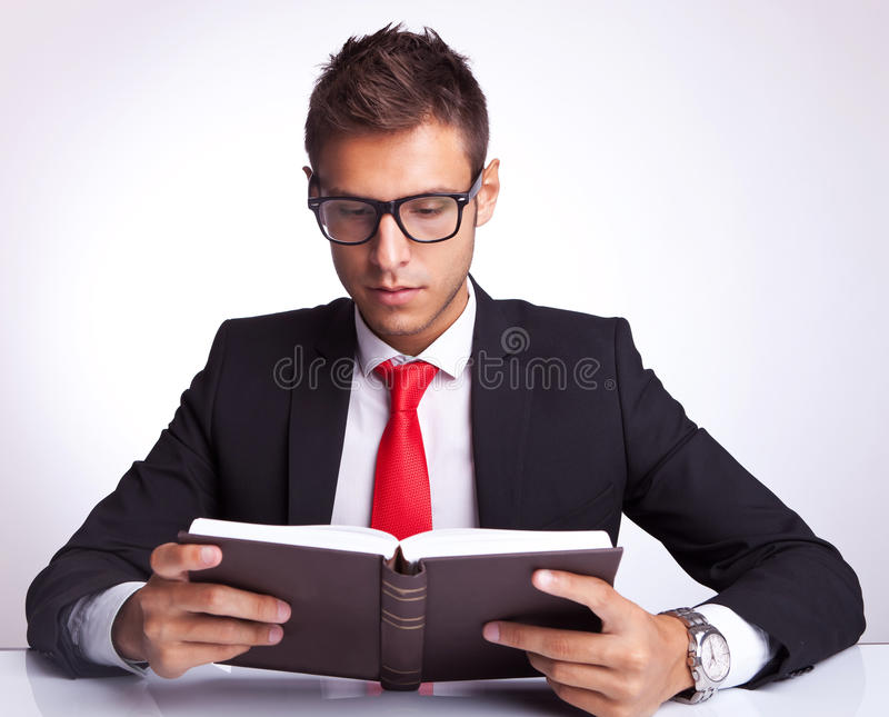 Download Business Man Wearing Glasses Reading A Book Stock Image - Image: 26587281