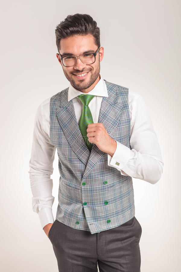 Business man wearing white shirt, grey vest and green tie. stock photo