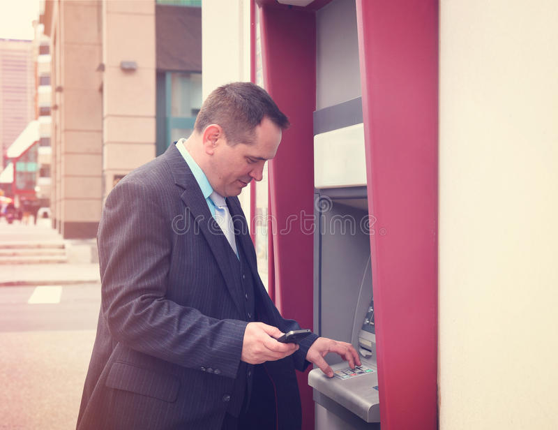 Business Man Withdrawing Money stock images