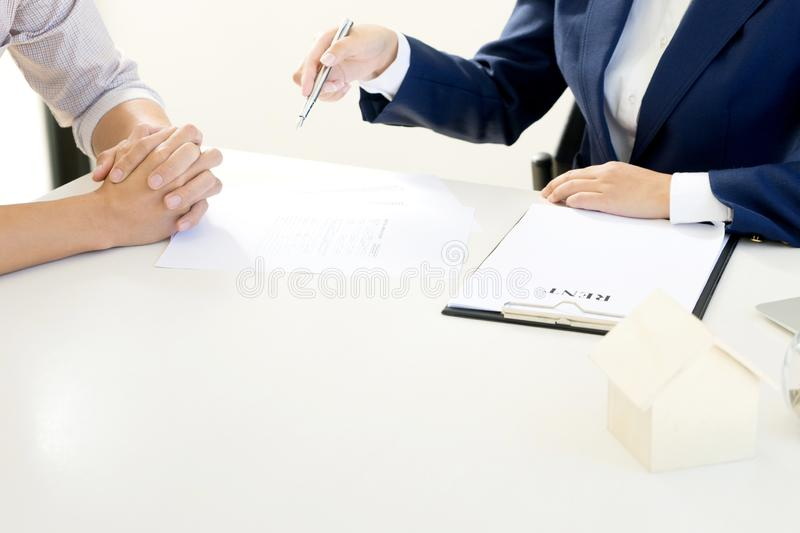 Business man woman agreement to sign for contract. For new home rent money in saving box glass bottle concept money collect royalty free stock photography