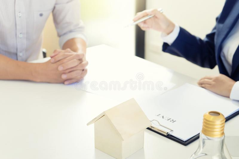Business man woman agreement to sign for contract. For new home rent money in saving box glass bottle concept money collect stock image