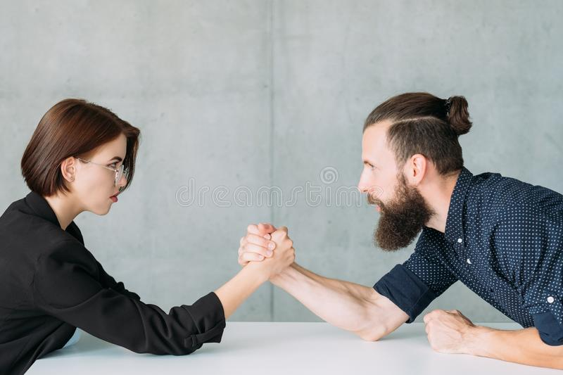 Business man woman arm wrestling competition royalty free stock photography