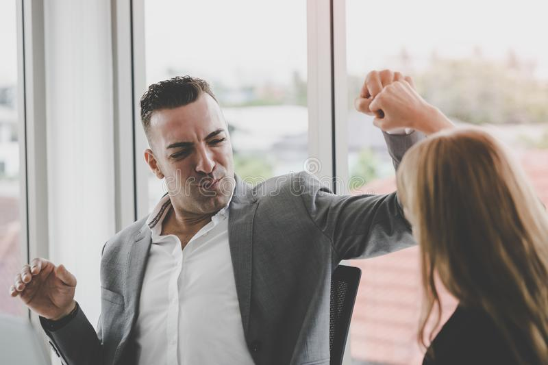 Business man and woman couple fist bump hand together f. Business men and women business couple fist bump hand together for team work stock photo