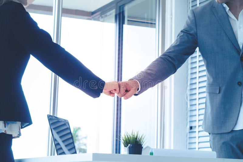 Business man and woman couple fist bump hand together f. Business men and women business couple fist bump hand together for team work royalty free stock image