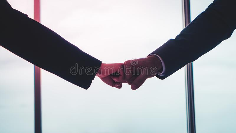 Business man and woman couple fist bump hand together f. Business man and woman business couple fist bump hand together for team work royalty free stock photo