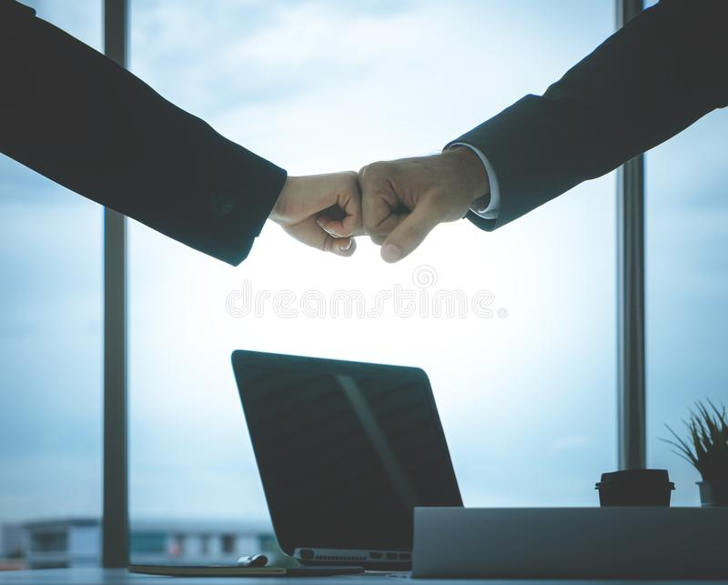 Business man and woman business fist bump hand together f. Business man and woman business couple fist bump hand together for team work royalty free stock photo