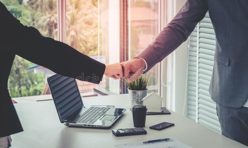 Business man and woman business fist bump hand together f. Business man and woman business couple fist bump hand together for team work stock image