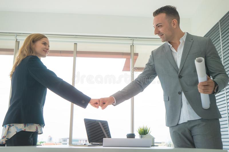Business man and woman couple fist bump hand together f. Business men and women business couple fist bump hand together for team work stock image