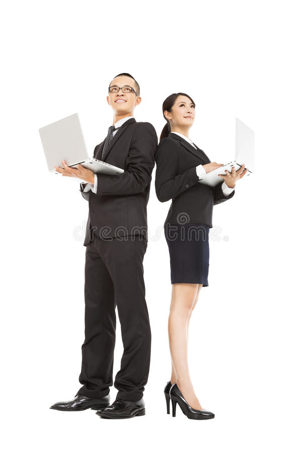 Business man and woman holding laptop stock images