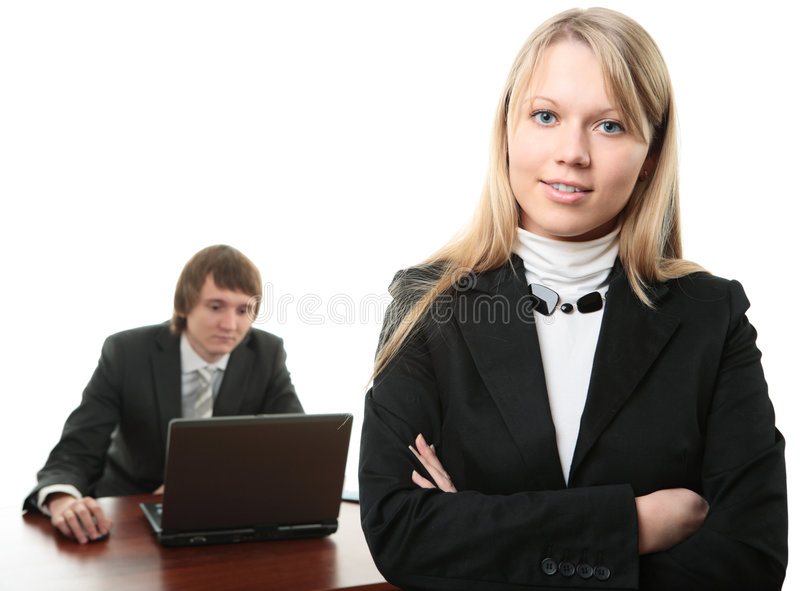 Business man and woman with laptop royalty free stock photo