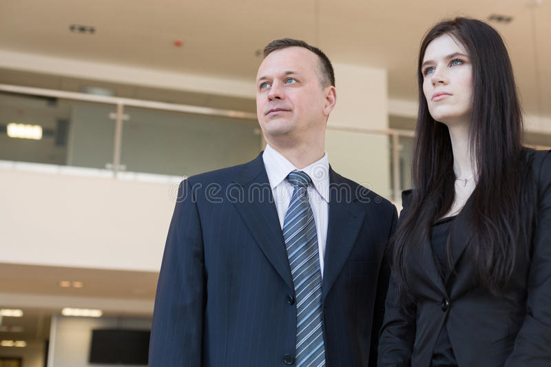 Business man and woman looking into the distance stock images