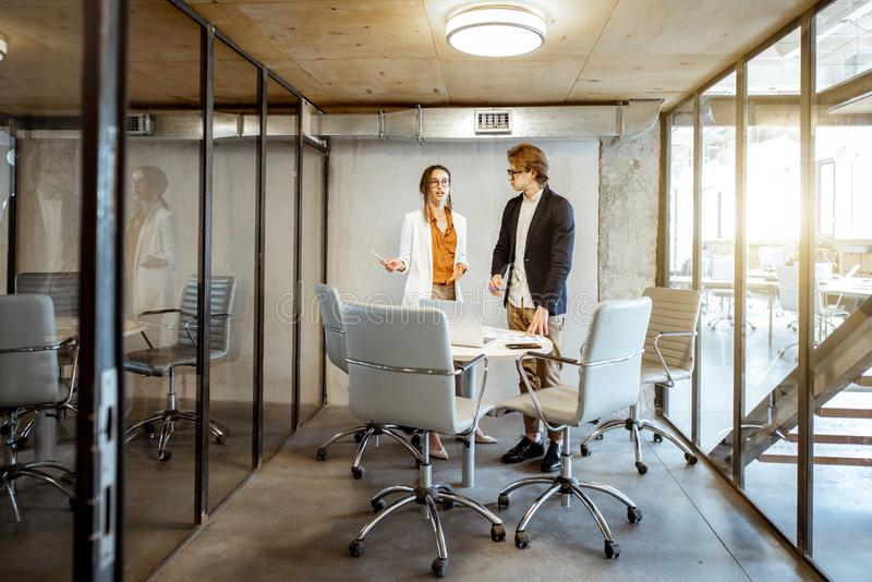 Business man and woman in the meeting room stock photography