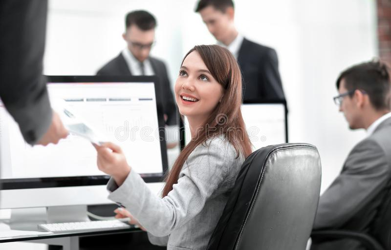 Young beautiful woman examines graphics sitting at her workplace. Business Man And Woman Showing Their Successful Teamwork On Computer stock photography