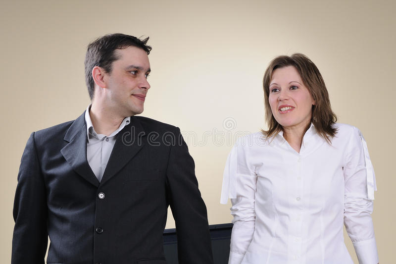 Business man and woman talking stock photography