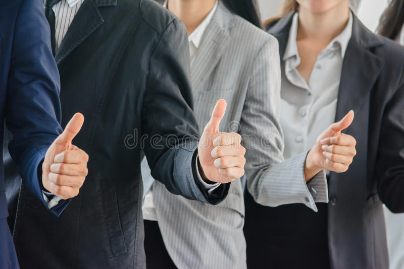 Business man and woman team ginving thumbs up. stock images
