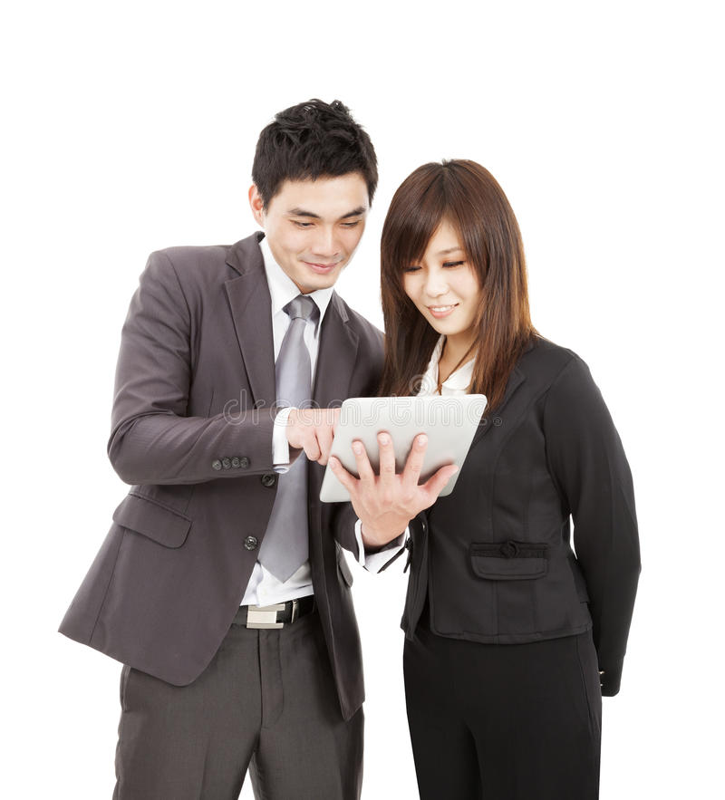 Download Business Man And Woman Using The Tablet Pc Stock Photo - Image: 27385720
