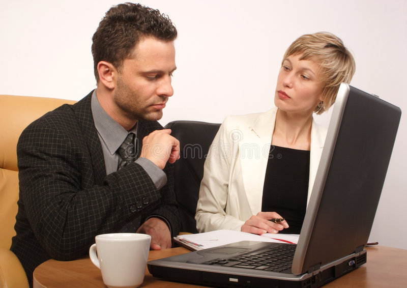 Business man & woman working together royalty free stock photo