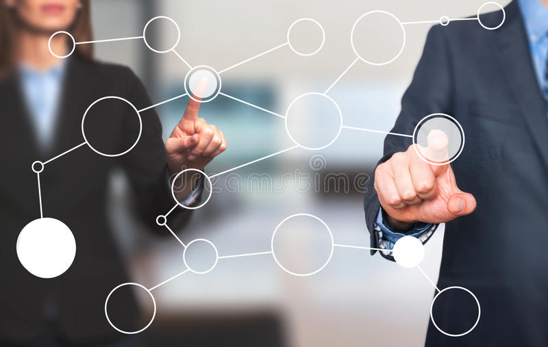 Business man and women hand drawing blank flow chart on new mode. Rn computer as concept. on office. Stock Image stock image