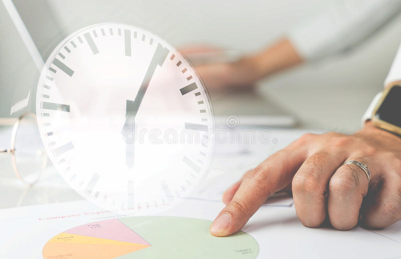 Business man is working againt clock stock photo