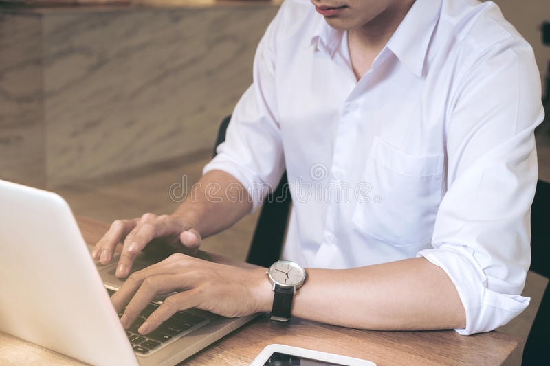 Business man working analyzing data in office, Image of confident executive analysis new financial project plan to investment wit. H laptop and digital tablet on stock image