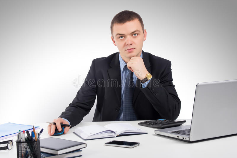 Business man working with documents and laptop royalty free stock photo