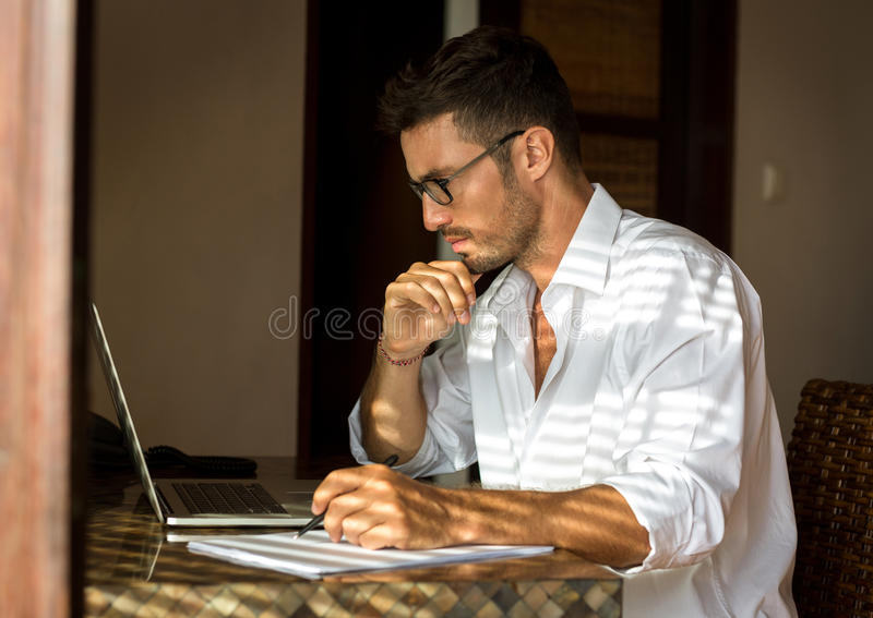 Business man working with documents and laptop stock images