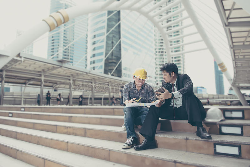 Business man is working with engineer stock photo