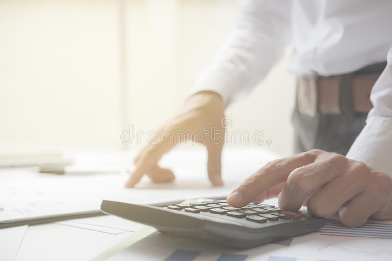 Business man working in his home office. Business concept stock images