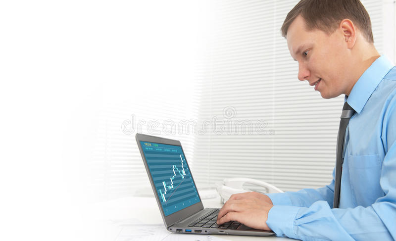 Business man working on his laptop royalty free stock photos