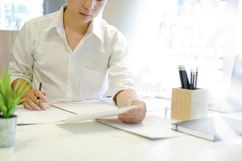 Business man working in his office. stock photos
