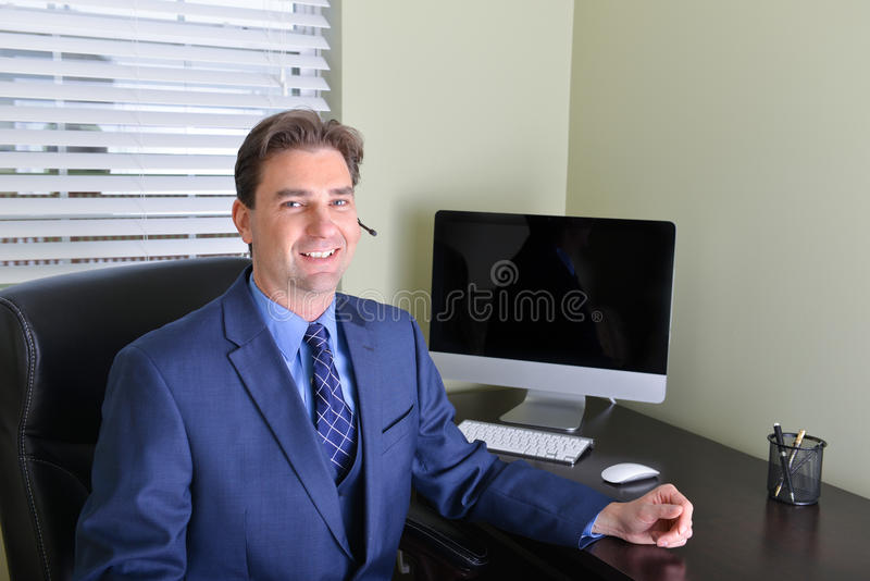 Business man working from home or customer service representative. Business man in work office or working from home office or customer service representative royalty free stock photo