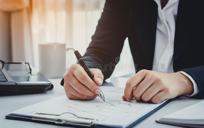Business man working at office and documents on she desk. Consultant lawyer concept royalty free stock photo