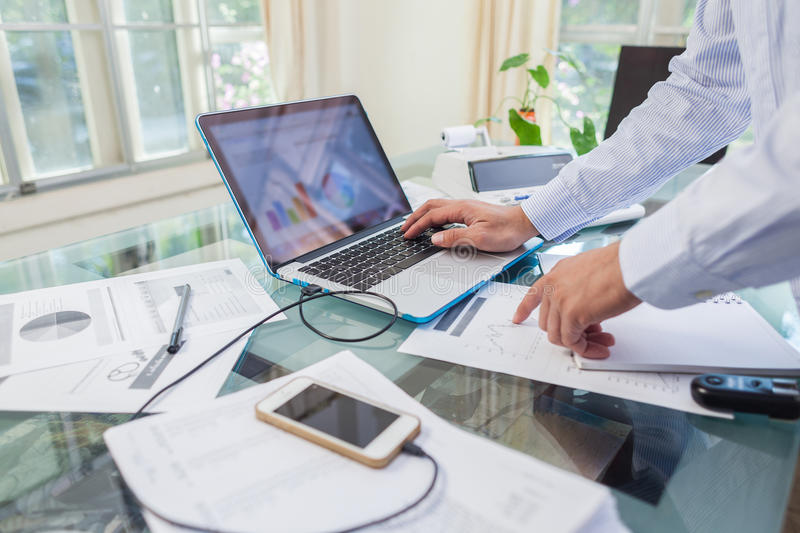Business man working on open laptop at home office. Location royalty free stock photos