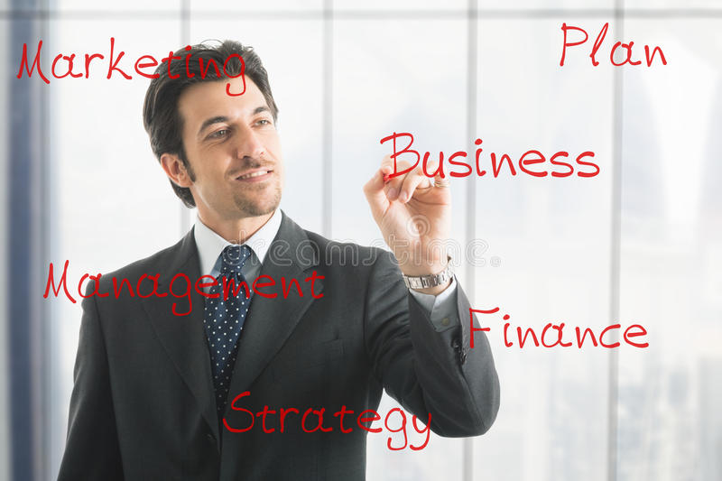 Business man writing business concepts royalty free stock photography