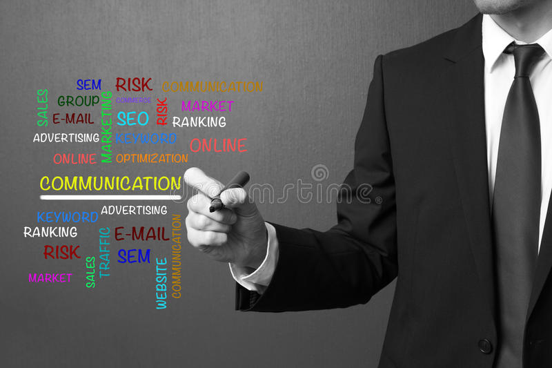 Business man writing COMMUNICATION word cloud, business concept royalty free stock photos
