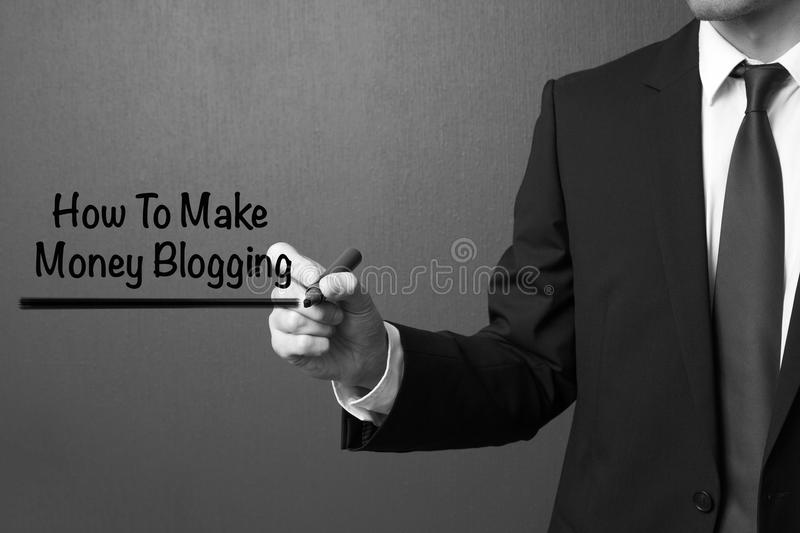 Business man writing How to make money blogging royalty free stock photos