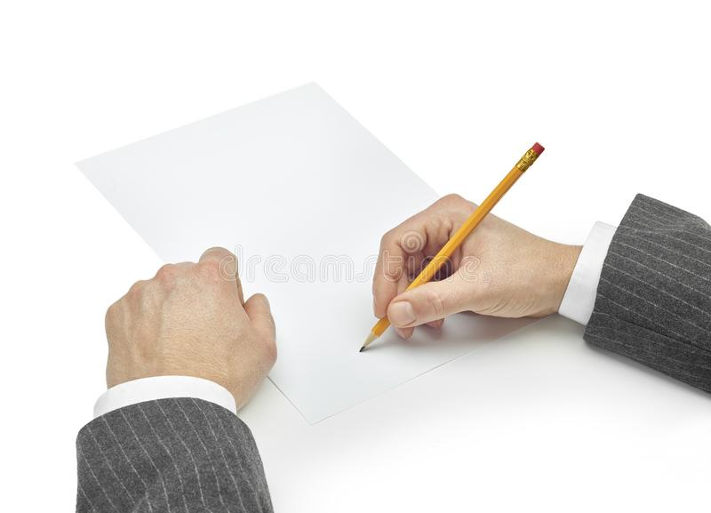 Business man writing on paper royalty free stock photo